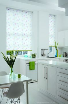 Red white and blue floral roller blinds in a white and lime green kitchen