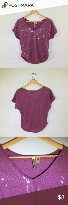 Eyeshadow Sparkly Top If sequence is your game, you'll love this purple glamorous top. T-shirt material with v-neck. 85% Polyester, 15% Linen. Eyeshadow Tops Tees - Short Sleeve