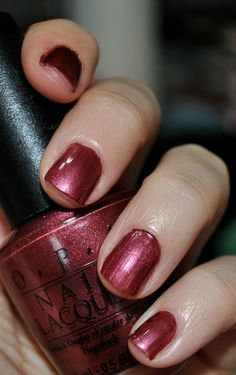 OPI From The British Collection, God Save The Queen's Nails. A really pretty garnet burgundy, it was my favorite nail polish for years.