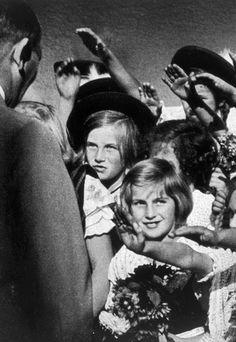 Children greeting Adolf Hitler, 1935. (via axishistory)