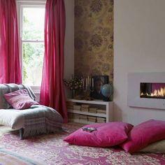 reading corner with fuschia pink floor pillows