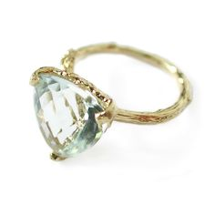 Aquamarine Forest Jewel  £1,200.00     This ring has a beautiful 12mm aquamarine stone with a trillion checkerboard cut, set in a solid 18ct yellow gold, delicate twig ring.   The stone is 12mm across and sits approximately 8mm tall atop the ring.