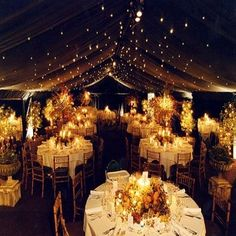 Love the use of varying heights in centerpieces and the twinkle lights on the top of the tent is gorgeous