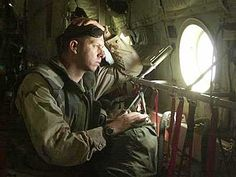 Lt. j.g. David Goodrich, 34, from Chesapeake, Va., a navy flight nurse with the Fleet Hospital Portsmouth, looks out the window of a KC-130, April 16, while he heads back to a Forward Resuscitation Surgical System in Iraq after escorting an injured Marine to Kuwait for medical attention. (Jud McCrehin/Marine Corps Times) © 2003, Gannett News Service #judmccrehinphotography #warphotography