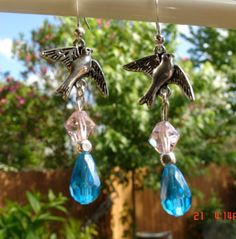 Nice Bird charm earrings with crystal accents, and silver color beaded accent.  These are very lightweight earrings.