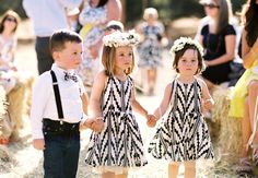 These patterned flower girl dresses match the ring bearer's bow tie // Braedon Photography