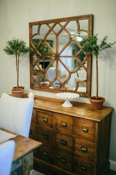 Wooden mirror at entryway