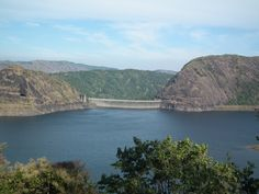 Idukki Arc Dam.  This is the Asia's first arch dam. You will be mesmerized by the scenic charm rendered in here. The encompassing hills Kuravan and Kurathi provide the perfect scenery for it.