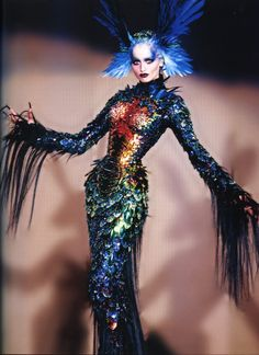 Adriana Sklenarikova wears the Chimere dress: a sheath dress resembling a mythical beast, with and articulated gold body made from scales, feathers and horsehair, and embroidered rhinestones. La Chimere Couture Collection A/W 1997-98 Thierry Mugler: Galaxy Glamour