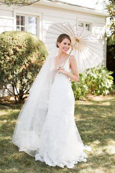 Beautiful bride in a Selia Yang wedding dress: http://www.stylemepretty.com/little-black-book-blog/2017/03/27/nautical-vintage-travel-inspired-elegant-beach-club-wedding/ Photography: Melissa Kruse - http://www.melissakruse.com/