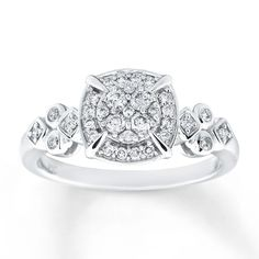 This sparkling engagement ring for her is crowned with a field of diamonds for an undeniable wow factor. More diamonds shimmer within circular and square-shaped settings along the sides, bringing the total diamond weight to 1/3 carat. The ring is styled in 10K white gold. From the Now & Forever® Bridal Collection. Diamond Total Carat Weight may range from .29 - .36 carats.