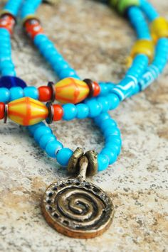 Blue Skies: Long African Inspired Turquoise Blue Glass Spiral Pendant Necklace