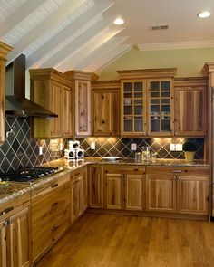 hickory cabinets kitchen design ideas wood flooring gas cooktop tile backsplash
