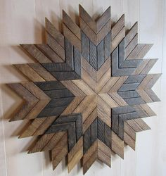Check out this beautiful Reclaimed Wood Sunburst Wall Art! This Barn Quilt is made from reclaimed tobacco lath that has been stored in a Lancaster County barn. Lancaster County, Pennsylvania is known for its beautiful farmland and growing tobacco. The lath was once used to hang