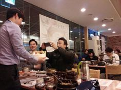 Misaeng: Lee Sung Min takes a picture of his birthday cake. Aww...
