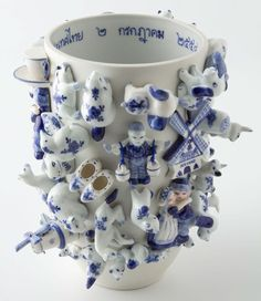 Vase designed by Dutch designer Carla Peters. She made them out of little ceramic trinkets (meant to look like famous Dutch Delft Blue ceramics) made in Thailand to be exported to the Netherlands as tourist souvenirs. Blue And White China, Blue China, Delft, Ceramic Pottery, Ceramic Art, Kintsugi, Vase, White Porcelain, My Favorite Color