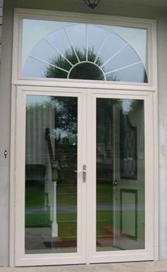 Double larson storm doors give the look of french doors for Storm doors for french doors