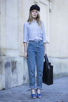 Denim in street style. Mum jeans and a fishermans cap at Paris Fashion Week Spring 2015. #pfw