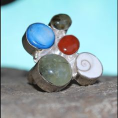 COMING SOON! Vtg Huge Mod Stone/ Shell Silver Ring Sterling silver handmade ring with different stones and shell.  Hallmarked 925  Large statement piece. 3 cm wide across.  Size 7.5 Vintage Jewelry Rings