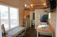 The Cedar Ridge: a cabin-style tiny home that measures 8.5' x 24'. Designed and built by Free Range Tiny Homes.