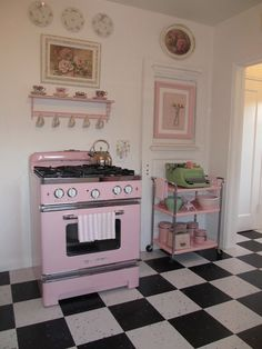 Retro pink stove and vintage pink cart.