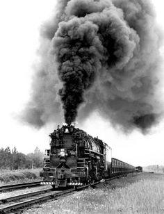 Duluth Missabe & Iron Range Railway 2-8-8-4 Baldwin M3 class Yellowstone steam locomotive # 222, is seen leading an iron ore train in Minnes...