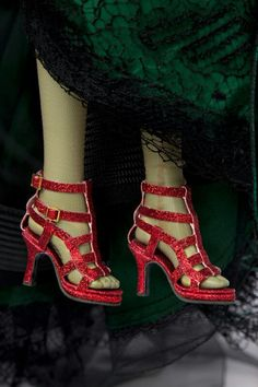 Wicked Witch? In designer ruby slippers; she can leave Dorothy alone now she has her own pair ... part of the Tonner Collection being auctioned for Habitat for Humanity.