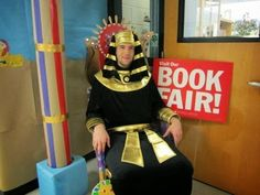 Book Fair-oh sits on his throne greeting students
