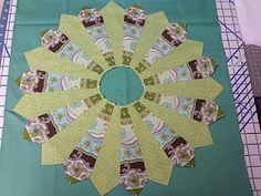 "Dresden Plate Quilt Block Tutorial - I like the look of the ""striped"" fabric."