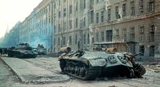 Heavy tank hit on the street in Budapest near the cinema Corvinus. As a result of explosion of ammunition from the tank tore off a turret. Prague Spring, Back In The Ussr, Military Armor, Tank I, Budapest Hungary, Modern Warfare, Panzer, Armored Vehicles, Held