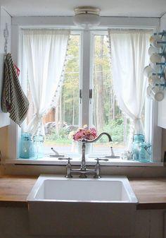 Love the kitchen window treatment