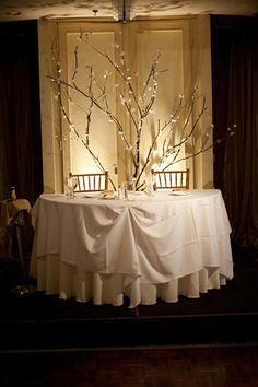 sweatheart table backdrop....such a romantic setting for a couple's first meal together as husband and wife!