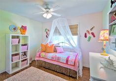 Design Dazzle blog - girls rooms - this bed has a grass skirt... I've seen someone's blog where they made a rose petal pillow.... I BET I could make a  mermaid scaled bed skirt in a similar way.....!!!