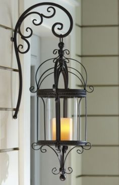 Set of 2 Hanging Lanterns from Through the Country Door®. LOVE the arm! Hanging Lanterns, Candle Lanterns, Candle Sconces, Lanterns Decor, Porch Lighting, Outdoor Lighting, Wrought Iron Decor, Citronella Candles, Front Door Decor