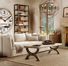 Washed stucco color of walls, wood and wicker natural elements, oversized clock.....it's the lack of bright colors that is soothing, wish I could be that person, in one room!
