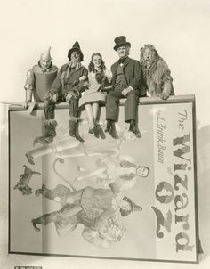 """2/10/14  12:55p MGM  """"The Wizard of Oz""""  Incredible piece of Studio Art Work,  Five of the Primary Characters in the film: The Tin Man, Scarecrow, Dorothy, Professor Marvel/Wizard ( He plays a total of FIVE characters!) and The Cowardly Lion,  sit on top of a very large Poster and/or Book Prop from the film. nymag.com"""