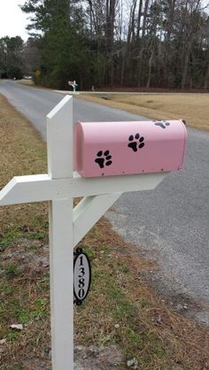 Mailbox ideas.  So I just HAD to be different with my pink mailbox and vinyl paw prints.  Love it!