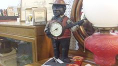 BLACK AMERICANA CAST IRON CLOCK $85.00, DEALER 102, COLORADO AVE AND BOOTH 21 AT THE BRASS ARMADILLO IN GRAIN VALLEY, MO. SHIPPING IS AVAILABLE FOR AN ADDITIONAL FEE.