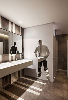 Bathroom with counter trash hole cut-out and trash can. Turkcell Maltepe Plaza by mimaristudio. Don't really like the mirror cutout, but this image has some cool ideas for a public bathroom.