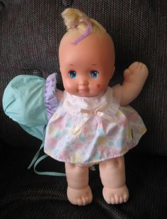 Magic Nursery Doll. When you kissed the heart on her cheek, it would change to a star. Also, to find out if it was a boy or a girl, you would dissolve the baby's nightie in water and inside was a birth certificate and an outfit. Mine was a girl. :)