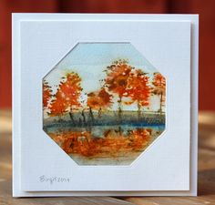 """Rapport från ett skrivbord. """"Christmas Park"""" by Penny Black was used by Birgit on this card. Gorgeous Autumn colours with a different shaped frame around the image make for another brilliant card by Birgit."""