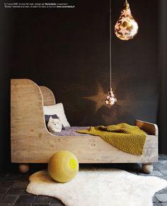 kid bed.  I love the color of that crochet kids blanket.  Must make