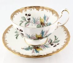 "Beautiful Set to add to your collection! Tea Cup has Gold Trim on the inside rim and Handle. Handle is a little faded from usage. No chips or cracks. Saucer has Gold Trim Tea Cup is approx. 2-1/4"" H x 4"" diameter. Saucer is 5-1/2"" diameter. Both have hand painted colorful flowers. Cup has the #31 stamp and the #7299 written in gold."