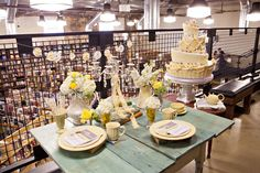 Spring wedding table. Yellow, cream, grey, white & touches of green. It's a book store wedding!