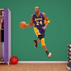 Honor One Of The Greatest Basketball Players All Time By Applying Fathead NBA Los Angeles Lakers Kobe Bryant Wall Decal To Your Sports Themed Room