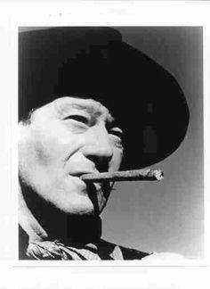 John Wayne smoking cigar.