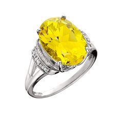 """From the """"Aspire Gemstone Collection"""", an oval shape lemon citrine ring featuring our special checkerboard cut faceting with 6 round diamonds set in 10kt white gold. .03tdw Available in both yellow and white gold."""