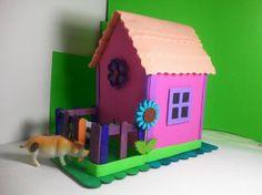 casita infantil en goma eva,palitos de helado,detalles decorativos pegado con silicona,recorte con tijeras