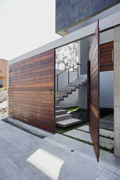 Entries: This is very cool. Could we do the front fence like this? Love the large concrete pavers surrounded by short grasses...