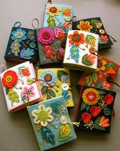 Larissa . needle books . They are all handmade of wool and wool-blend felts, and the covers have been fortified with fabric stiffener to make them a bit more durable. They each have a loop for hanging, and a button/string closure. Inside are four felt pages for parking your needles.